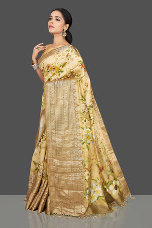 Shop graceful cream yellow floral muga saree online in USA with zari border. Be the center of attraction at weddings and parties with your captivating ethnic style in beautiful pure silk sarees. floral sarees from Pure Elegance Indian fashion store in USA.-side