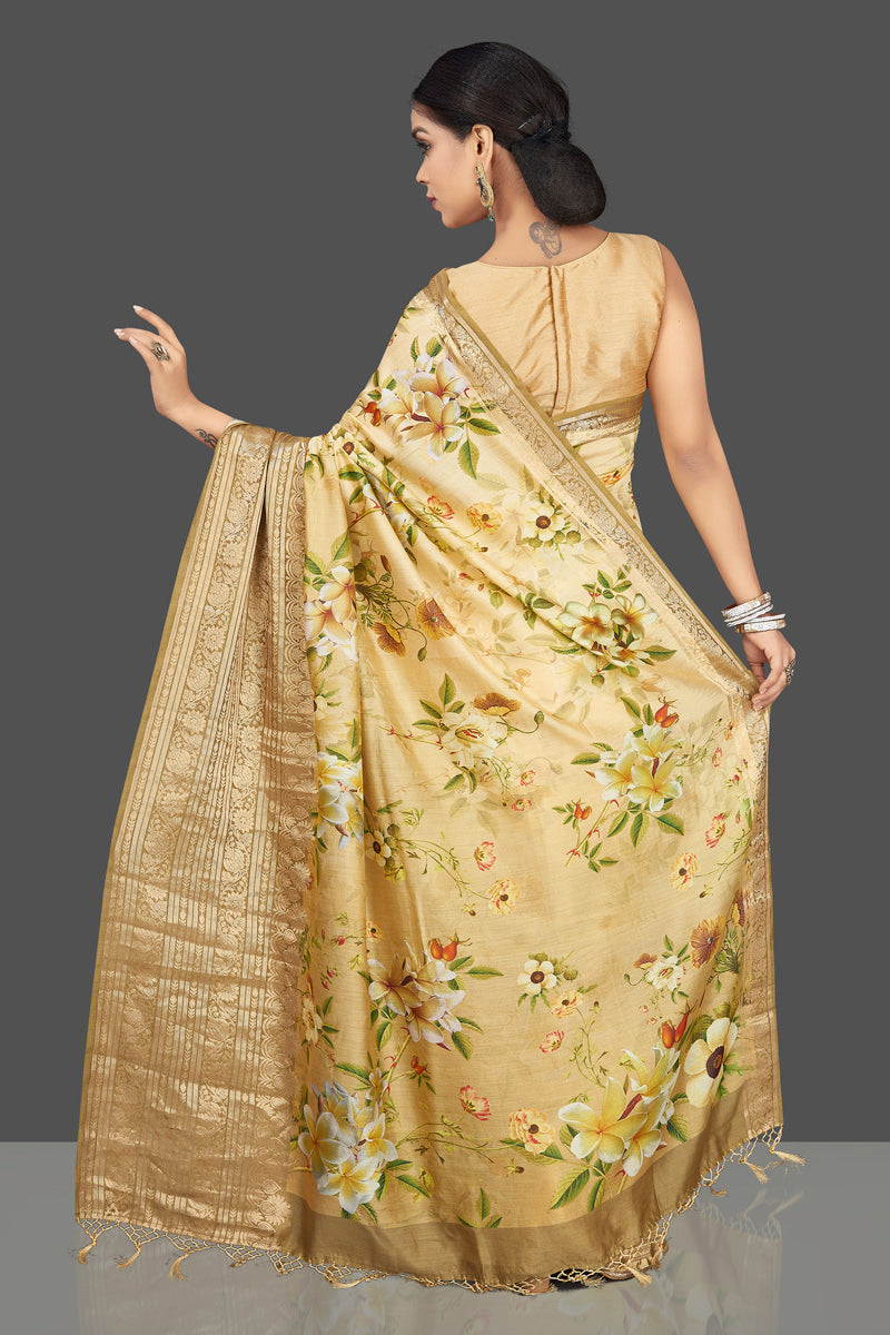 Shop graceful cream yellow floral muga saree online in USA with zari border. Be the center of attraction at weddings and parties with your captivating ethnic style in beautiful pure silk sarees. floral sarees from Pure Elegance Indian fashion store in USA.-back