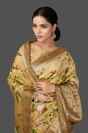 Shop graceful cream yellow floral muga saree online in USA with zari border. Be the center of attraction at weddings and parties with your captivating ethnic style in beautiful pure silk sarees. floral sarees from Pure Elegance Indian fashion store in USA.-closeup
