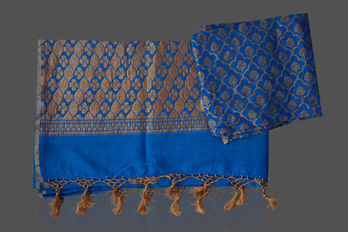 Shop gorgeous blue muga Benarasi saree online in USA with antique zari buta. Look charming on festivals and weddings with stunning Banarasi sarees, muga silk sarees, tussar sarees from Pure Elegance Indian clothing store. Your one stop destination for Indian fashion in USA!-blouse