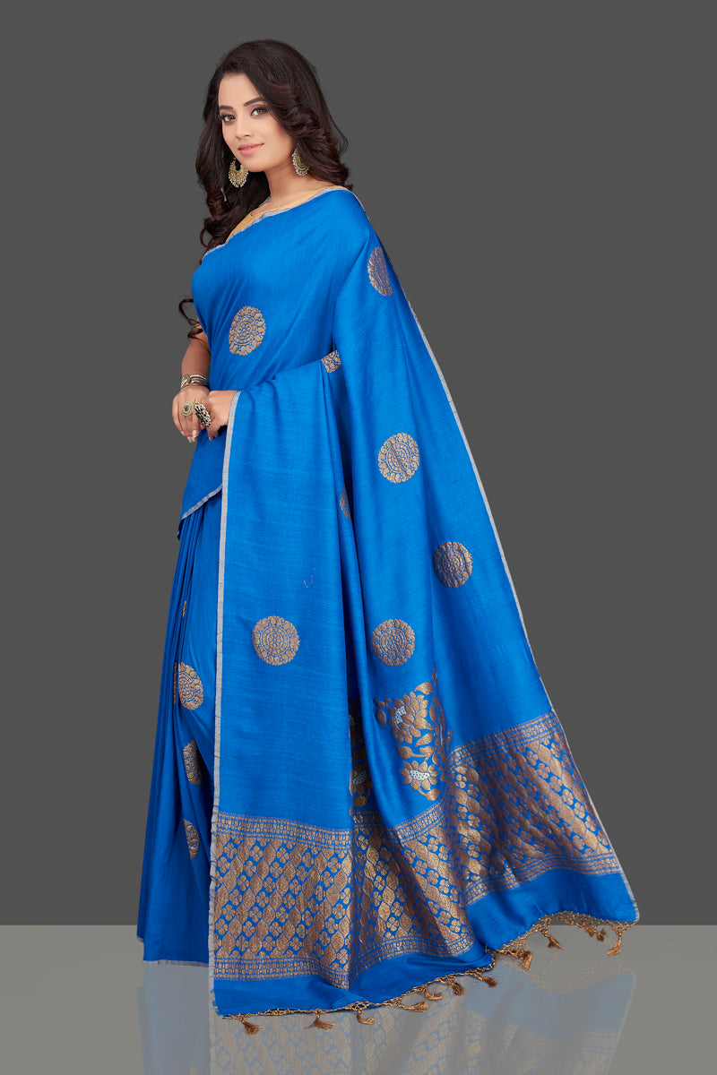 Shop gorgeous blue muga Benarasi saree online in USA with antique zari buta. Look charming on festivals and weddings with stunning Banarasi sarees, muga silk sarees, tussar sarees from Pure Elegance Indian clothing store. Your one stop destination for Indian fashion in USA!-full view