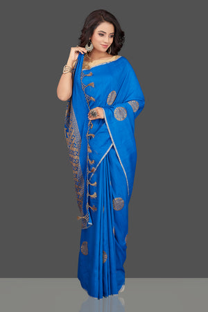 Shop gorgeous blue muga Benarasi saree online in USA with antique zari buta. Look charming on festivals and weddings with stunning Banarasi sarees, muga silk sarees, tussar sarees from Pure Elegance Indian clothing store. Your one stop destination for Indian fashion in USA!-front
