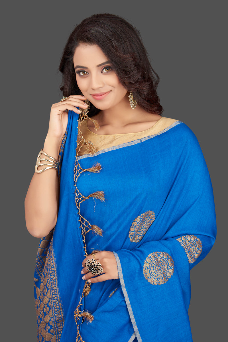 Shop gorgeous blue muga Benarasi saree online in USA with antique zari buta. Look charming on festivals and weddings with stunning Banarasi sarees, muga silk sarees, tussar sarees from Pure Elegance Indian clothing store. Your one stop destination for Indian fashion in USA!-closeup