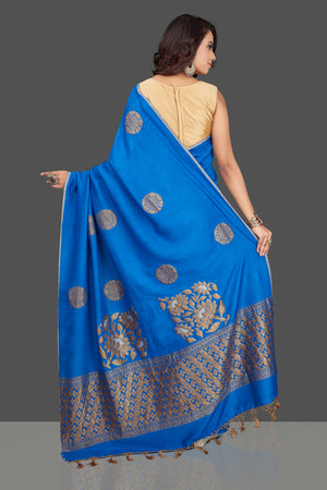 Shop gorgeous blue muga Benarasi saree online in USA with antique zari buta. Look charming on festivals and weddings with stunning Banarasi sarees, muga silk sarees, tussar sarees from Pure Elegance Indian clothing store. Your one stop destination for Indian fashion in USA!-back