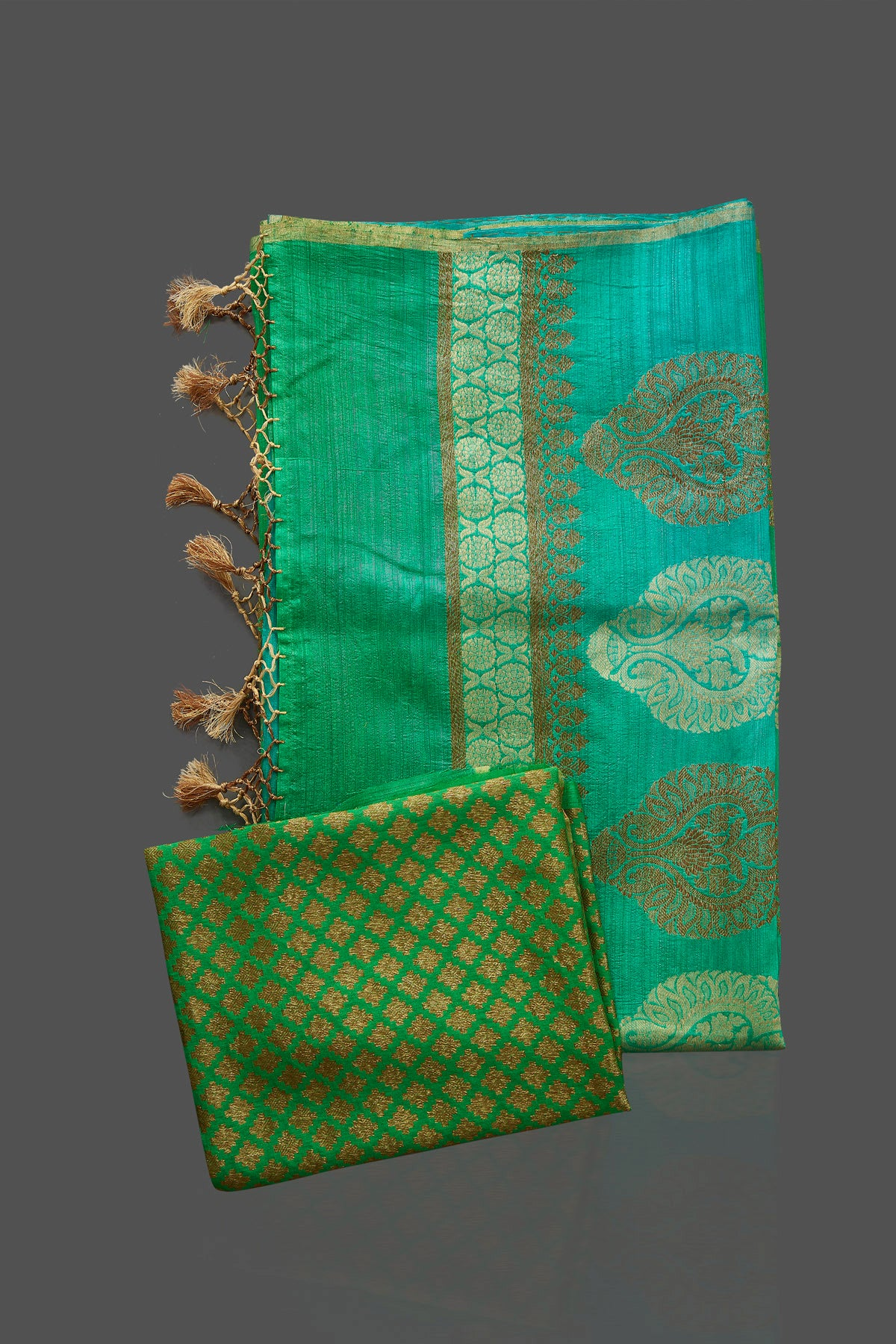 Buy beautiful bluish green tussar muga Banarasi saree online in USA with zari motifs pallu. Look charming on festivals and weddings with stunning Banarasi sarees, muga silk sarees, tussar sarees from Pure Elegance Indian clothing store. Your one stop destination for Indian fashion in USA!-blouse