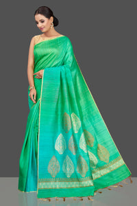 Buy beautiful bluish green tussar muga Banarasi saree online in USA with zari motifs pallu. Look charming on festivals and weddings with stunning Banarasi sarees, muga silk sarees, tussar sarees from Pure Elegance Indian clothing store. Your one stop destination for Indian fashion in USA!-full view
