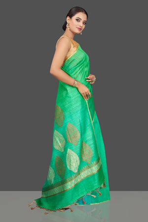 Buy beautiful bluish green tussar muga Banarasi saree online in USA with zari motifs pallu. Look charming on festivals and weddings with stunning Banarasi sarees, muga silk sarees, tussar sarees from Pure Elegance Indian clothing store. Your one stop destination for Indian fashion in USA!-side