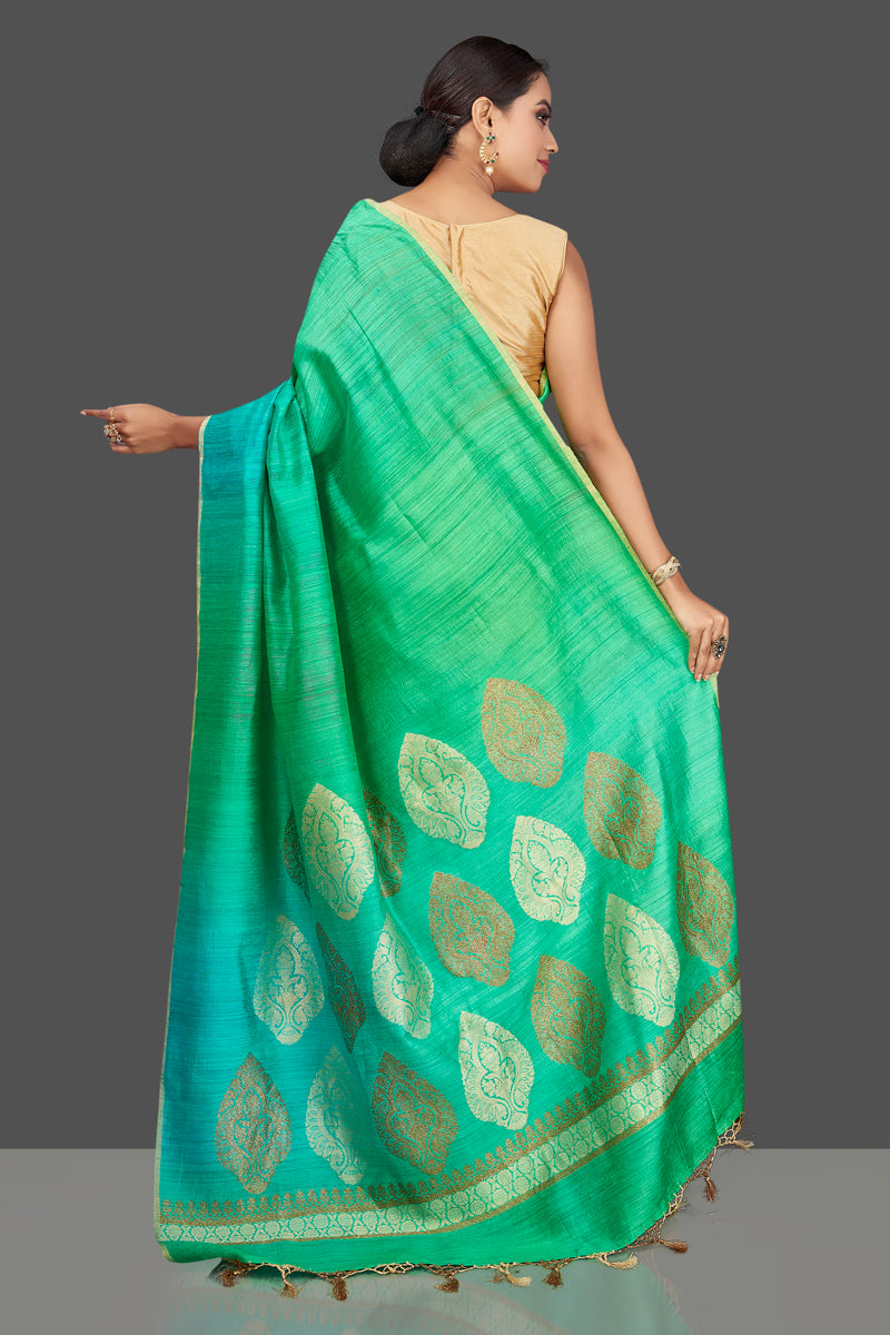 Buy beautiful bluish green tussar muga Banarasi saree online in USA with zari motifs pallu. Look charming on festivals and weddings with stunning Banarasi sarees, muga silk sarees, tussar sarees from Pure Elegance Indian clothing store. Your one stop destination for Indian fashion in USA!-back