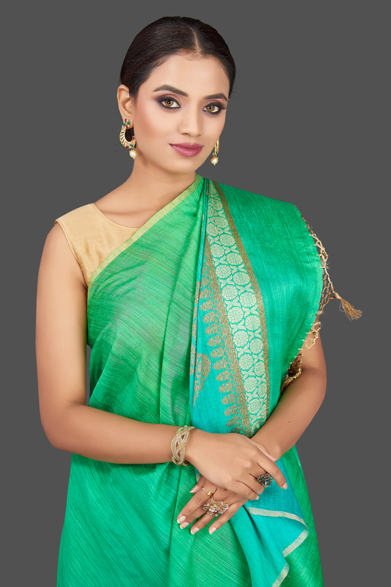 Buy beautiful bluish green tussar muga Banarasi saree online in USA with zari motifs pallu. Look charming on festivals and weddings with stunning Banarasi sarees, muga silk sarees, tussar sarees from Pure Elegance Indian clothing store. Your one stop destination for Indian fashion in USA!-closeup