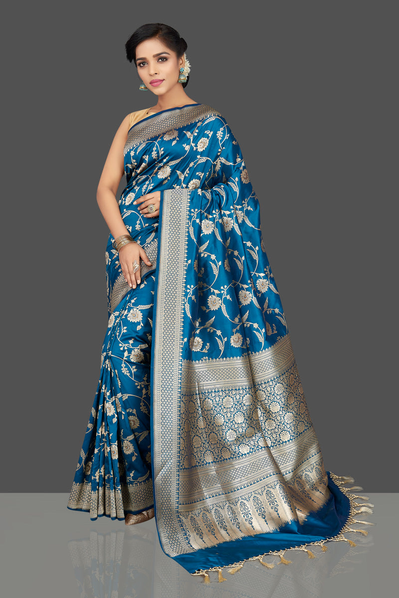 Buy traditional blue floral zari work Banarsi silk saree online in USA with zari border. Be the center of attraction at weddings and parties with your captivating ethnic style in beautiful Banarsi silk sarees. zari work sarees from Pure Elegance Indian fashion store in USA.-full view