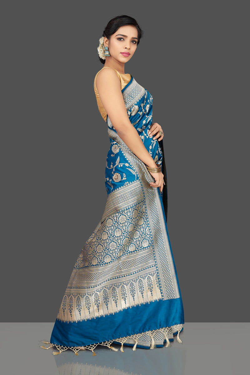 Buy traditional blue floral zari work Banarsi silk saree online in USA with zari border. Be the center of attraction at weddings and parties with your captivating ethnic style in beautiful Banarsi silk sarees. zari work sarees from Pure Elegance Indian fashion store in USA.-side