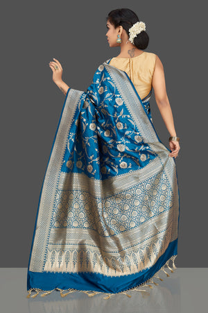Buy traditional blue floral zari work Banarsi silk saree online in USA with zari border. Be the center of attraction at weddings and parties with your captivating ethnic style in beautiful Banarsi silk sarees. zari work sarees from Pure Elegance Indian fashion store in USA.-back