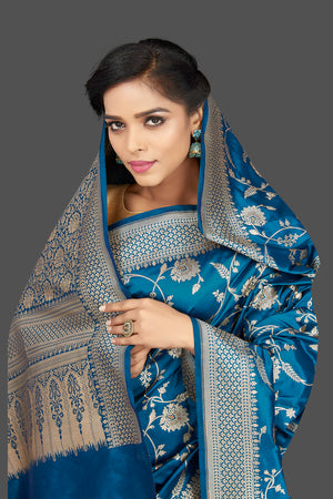 Buy traditional blue floral zari work Banarsi silk saree online in USA with zari border. Be the center of attraction at weddings and parties with your captivating ethnic style in beautiful Banarsi silk sarees. zari work sarees from Pure Elegance Indian fashion store in USA.-closeup