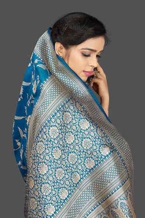 Buy traditional blue floral zari work Banarsi silk saree online in USA with zari border. Be the center of attraction at weddings and parties with your captivating ethnic style in beautiful Banarsi silk sarees. zari work sarees from Pure Elegance Indian fashion store in USA.-pallu