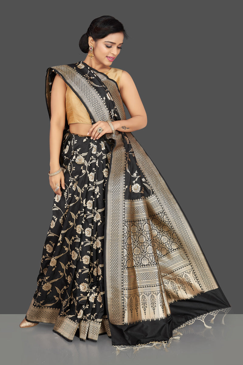 Shop regal black Banarasi silk sari online in USA with floral zari work. Be the center of attraction at weddings and parties with your captivating ethnic style in beautiful Banarsi silk sarees. zari work sarees from Pure Elegance Indian fashion store in USA.-full view