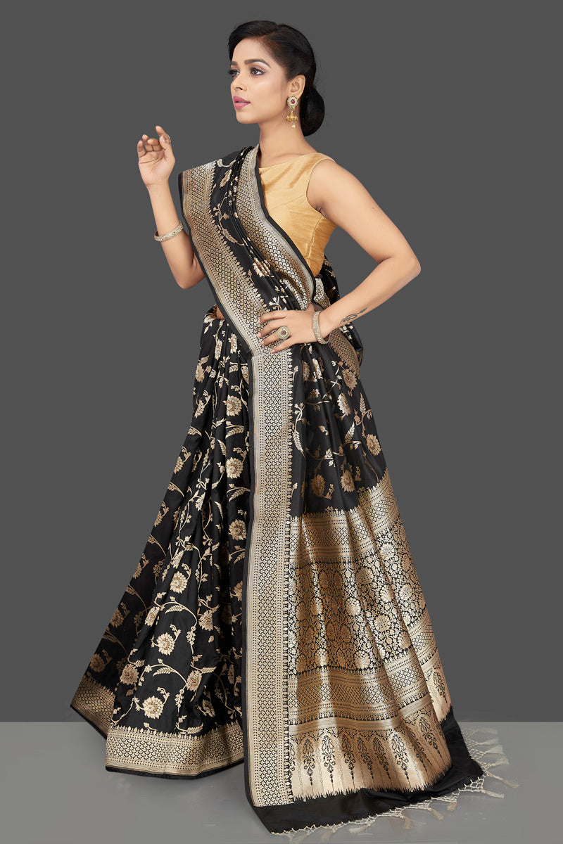 Shop regal black Banarasi silk sari online in USA with floral zari work. Be the center of attraction at weddings and parties with your captivating ethnic style in beautiful Banarsi silk sarees. zari work sarees from Pure Elegance Indian fashion store in USA.-left