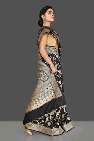 Shop regal black Banarasi silk sari online in USA with floral zari work. Be the center of attraction at weddings and parties with your captivating ethnic style in beautiful Banarsi silk sarees. zari work sarees from Pure Elegance Indian fashion store in USA.-right