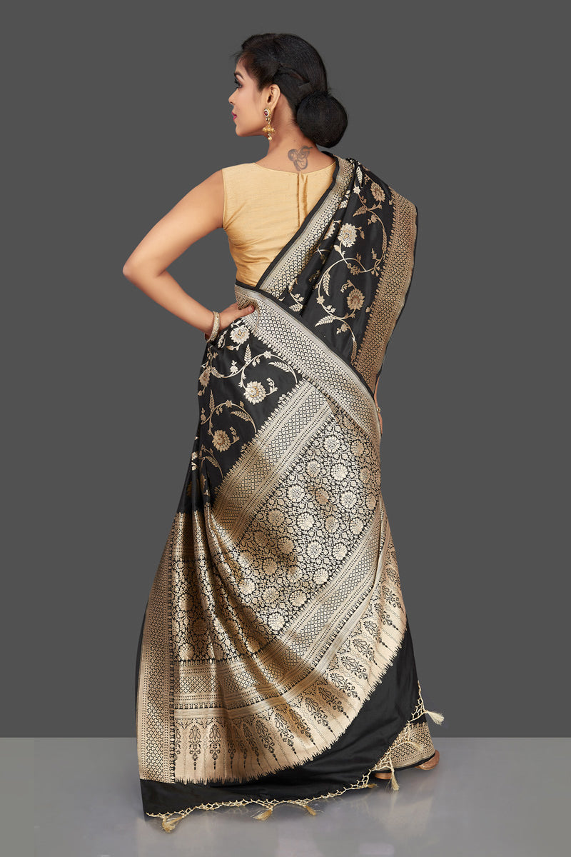 Shop regal black Banarasi silk sari online in USA with floral zari work. Be the center of attraction at weddings and parties with your captivating ethnic style in beautiful Banarsi silk sarees. zari work sarees from Pure Elegance Indian fashion store in USA.-back