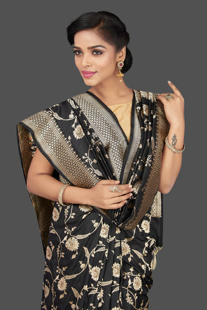 Shop regal black Banarasi silk sari online in USA with floral zari work. Be the center of attraction at weddings and parties with your captivating ethnic style in beautiful Banarsi silk sarees. zari work sarees from Pure Elegance Indian fashion store in USA.-closeup