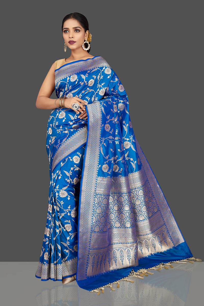 Shop beautiful blue Benarasi silk saree online in USA with silver zari floral work. Be the center of attraction at weddings and parties with your captivating ethnic style in beautiful Banarsi silk sarees. zari work sarees from Pure Elegance Indian fashion store in USA.-full view