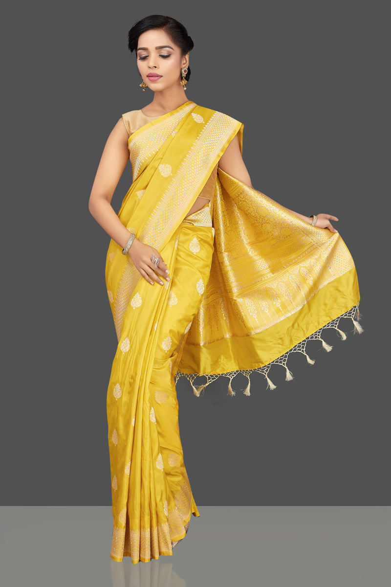 Shop yellow Benarasi silk sari online in USA with leaf zari buta. Be the center of attraction at weddings and parties with your captivating ethnic style in beautiful Banarsi silk sarees. zari work sarees from Pure Elegance Indian fashion store in USA.-full view