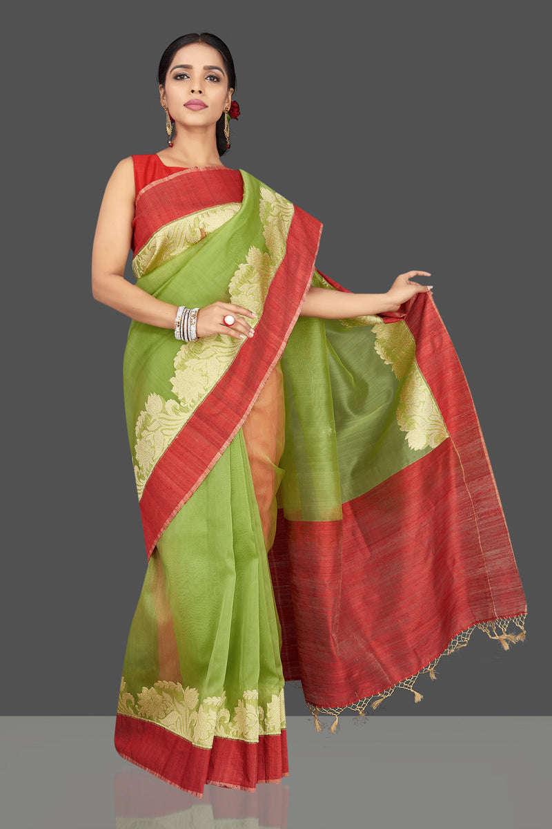 Buy green organza Banarasi saree online in USA with zari work on red border. Be the center of attraction at weddings and parties with your captivating ethnic style in beautiful Banarsi silk saris. tanchoi sarees from Pure Elegance Indian fashion store in USA.-full view
