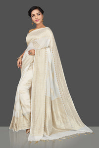 Shop gorgeous white tassar georgette Banarasi saree online in USA. Be the center of attraction at weddings and parties with your captivating ethnic style in beautiful Banarsi saris. tassar sarees, georgette sarees from Pure Elegance Indian fashion store in USA.-full view