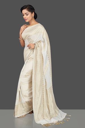 Shop gorgeous white tassar georgette Banarasi saree online in USA. Be the center of attraction at weddings and parties with your captivating ethnic style in beautiful Banarsi saris. tassar sarees, georgette sarees from Pure Elegance Indian fashion store in USA.-left side