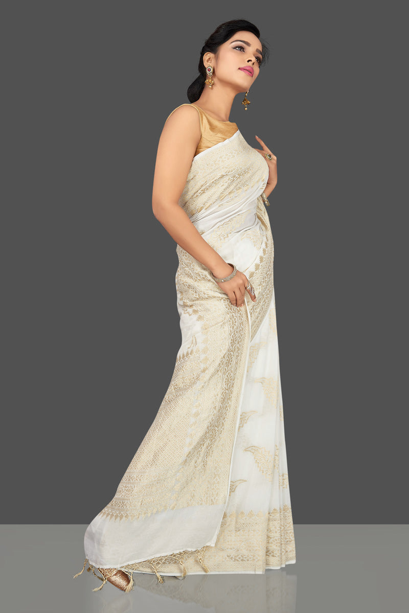 Shop gorgeous white tassar georgette Banarasi saree online in USA. Be the center of attraction at weddings and parties with your captivating ethnic style in beautiful Banarsi saris. tassar sarees, georgette sarees from Pure Elegance Indian fashion store in USA.-side