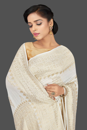 Shop gorgeous white tassar georgette Banarasi saree online in USA. Be the center of attraction at weddings and parties with your captivating ethnic style in beautiful Banarsi saris. tassar sarees, georgette sarees from Pure Elegance Indian fashion store in USA.-closeup