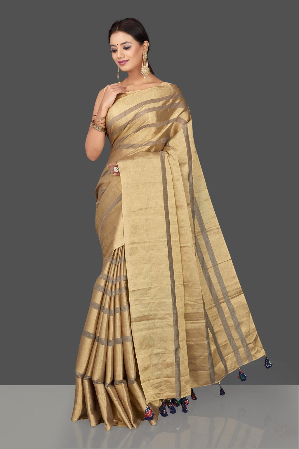 Shop golden tissue tassar saree online in USA with blue tassels on pallu. Keep it elegant with handwoven saris, Tassar silk sarees, tissue sarees from Pure Elegance Indian fashion boutique in USA. We bring a especially curated collection of ethnic sarees for Indian women in USA under one roof!-full view