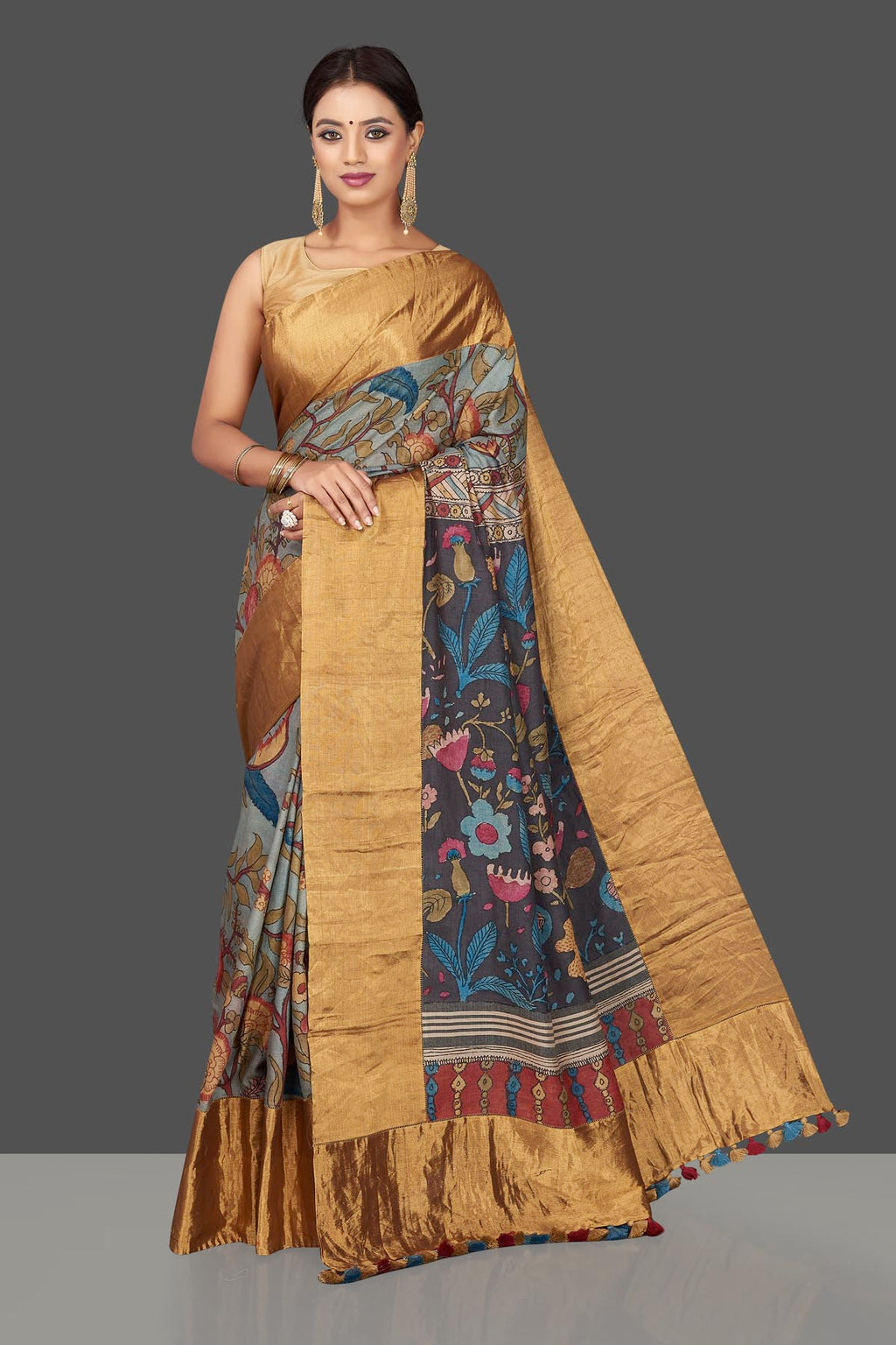Buy stunning light grey hand painted Kalamkari sari online in USA with golden tissue border. Keep it elegant with handpainted silk sarees, Kalamakari sarees from Pure Elegance Indian fashion boutique in USA.-full view