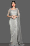 Shop beautiful light grey embroidered saree online in USA with feather sleeves saree blouse. Shine at parties with glamorous designer sarees, Bollywood sarees from Pure Elegance Indian fashion store in USA.-full view