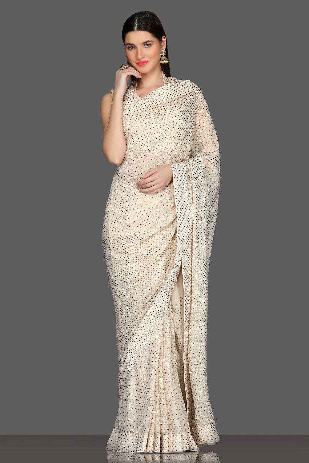 Buy elegant off-white designer saree online in USA with matching saree blouse. Shine at parties with glamorous designer sarees, Bollywood sarees from Pure Elegance Indian fashion store in USA.-full view