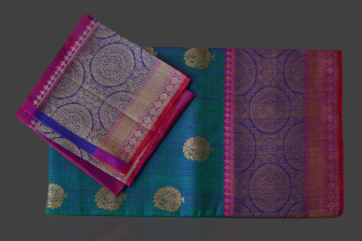 Buy stunning greenish blue tassar Banarasi sari online in USA with antique zari purple and blue border and zari buta. Garner compliments on weddings and special occasions with exquisite Banarasi saris, handwoven silk sarees, tussar sarees from Pure Elegance Indian fashion store in USA.-blouse