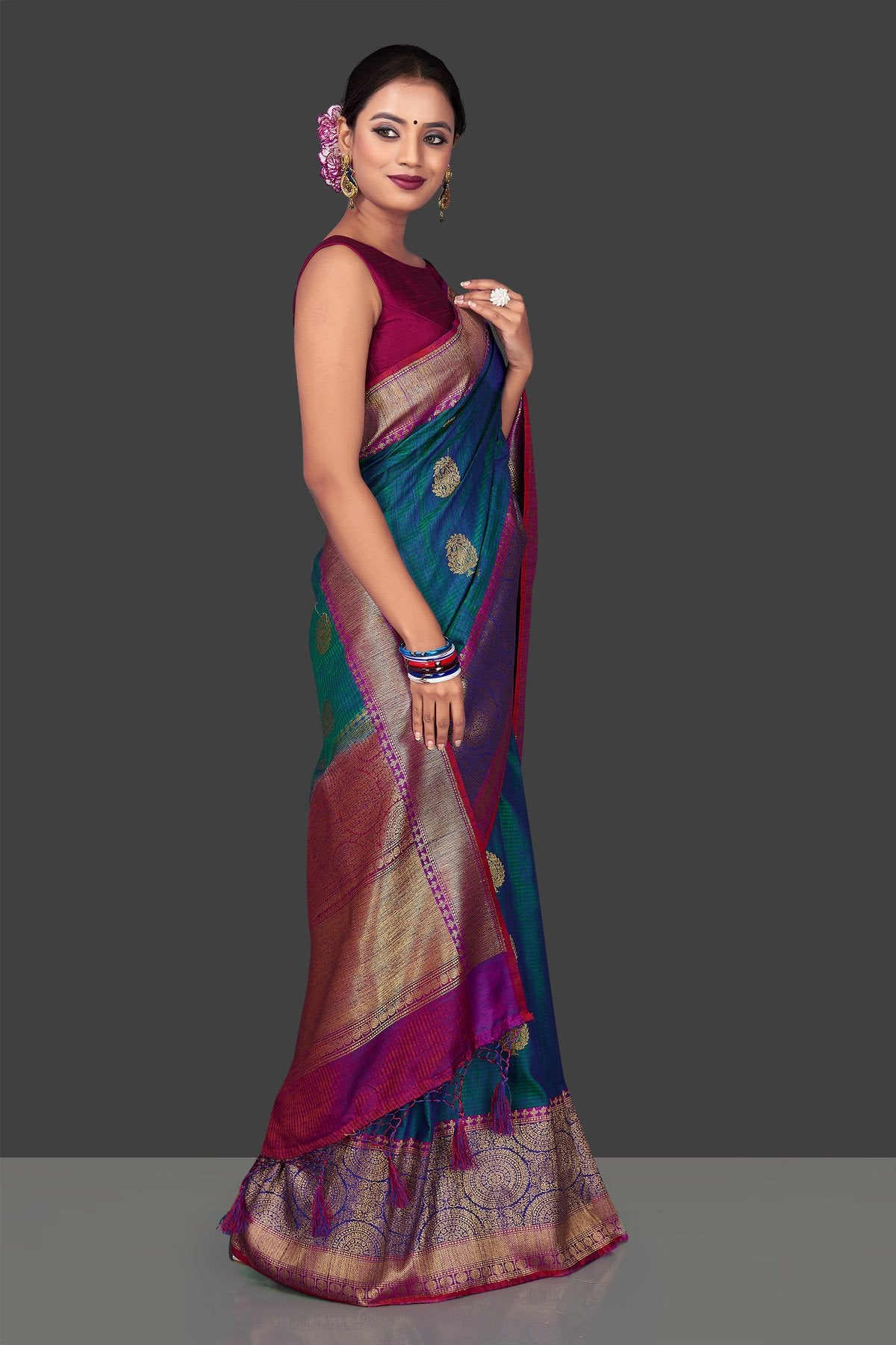 Buy stunning greenish blue tassar Banarasi sari online in USA with antique zari purple and blue border and zari buta. Garner compliments on weddings and special occasions with exquisite Banarasi saris, handwoven silk sarees, tussar sarees from Pure Elegance Indian fashion store in USA.-right
