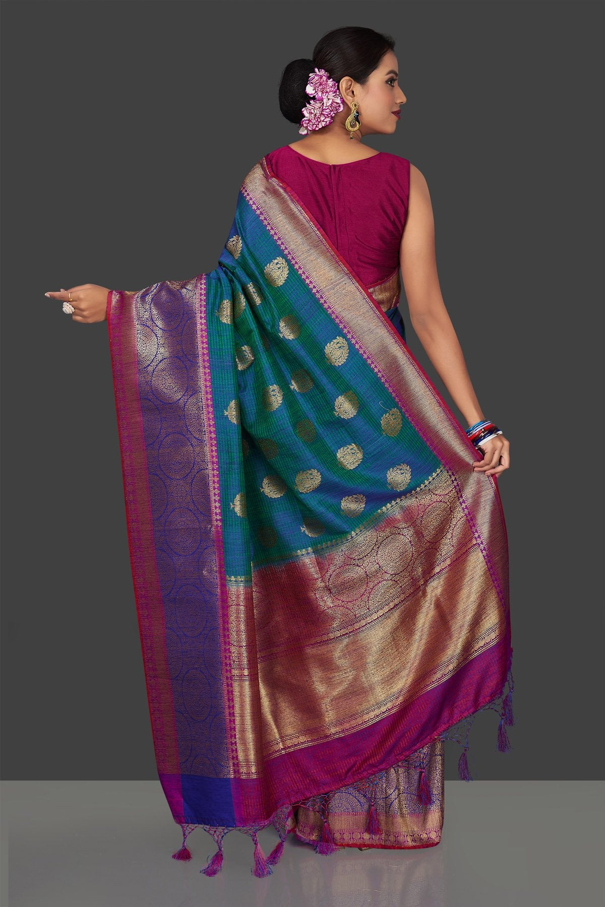 Buy stunning greenish blue tassar Banarasi sari online in USA with antique zari purple and blue border and zari buta. Garner compliments on weddings and special occasions with exquisite Banarasi saris, handwoven silk sarees, tussar sarees from Pure Elegance Indian fashion store in USA.-back