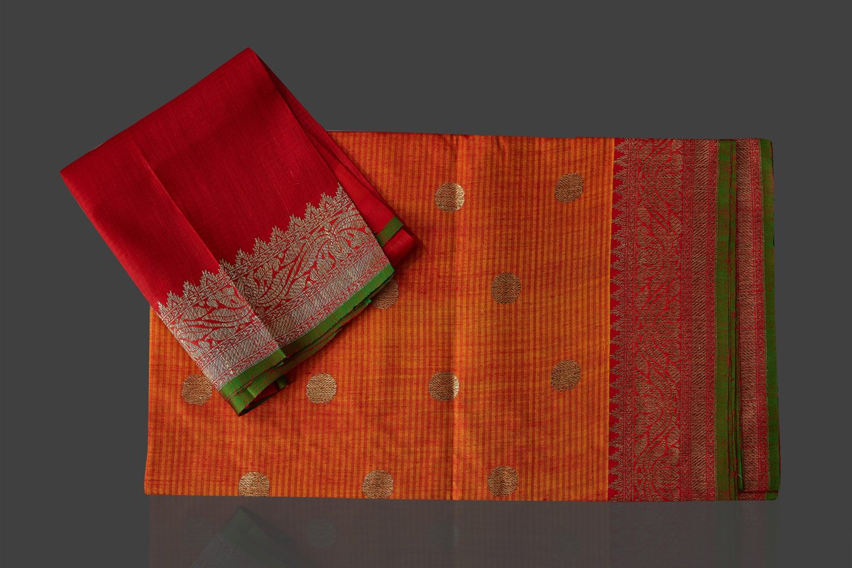 Shop beautiful orange tassar Banarasi saree online in USA with antique zari red border and zari buta. Garner compliments on weddings and special occasions with exquisite Banarasi saris, handwoven silk sarees, tussar sarees from Pure Elegance Indian fashion store in USA.-blouse