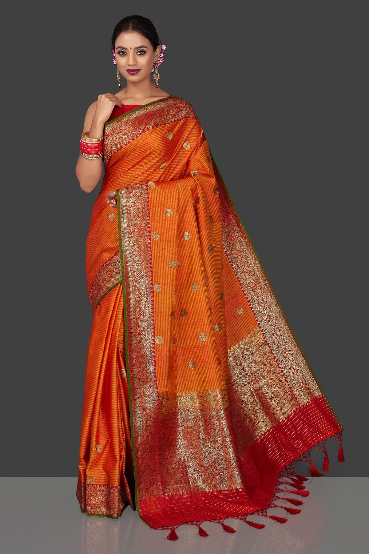 Shop beautiful orange tassar Banarasi saree online in USA with antique zari red border and zari buta. Garner compliments on weddings and special occasions with exquisite Banarasi saris, handwoven silk sarees, tussar sarees from Pure Elegance Indian fashion store in USA.-full view