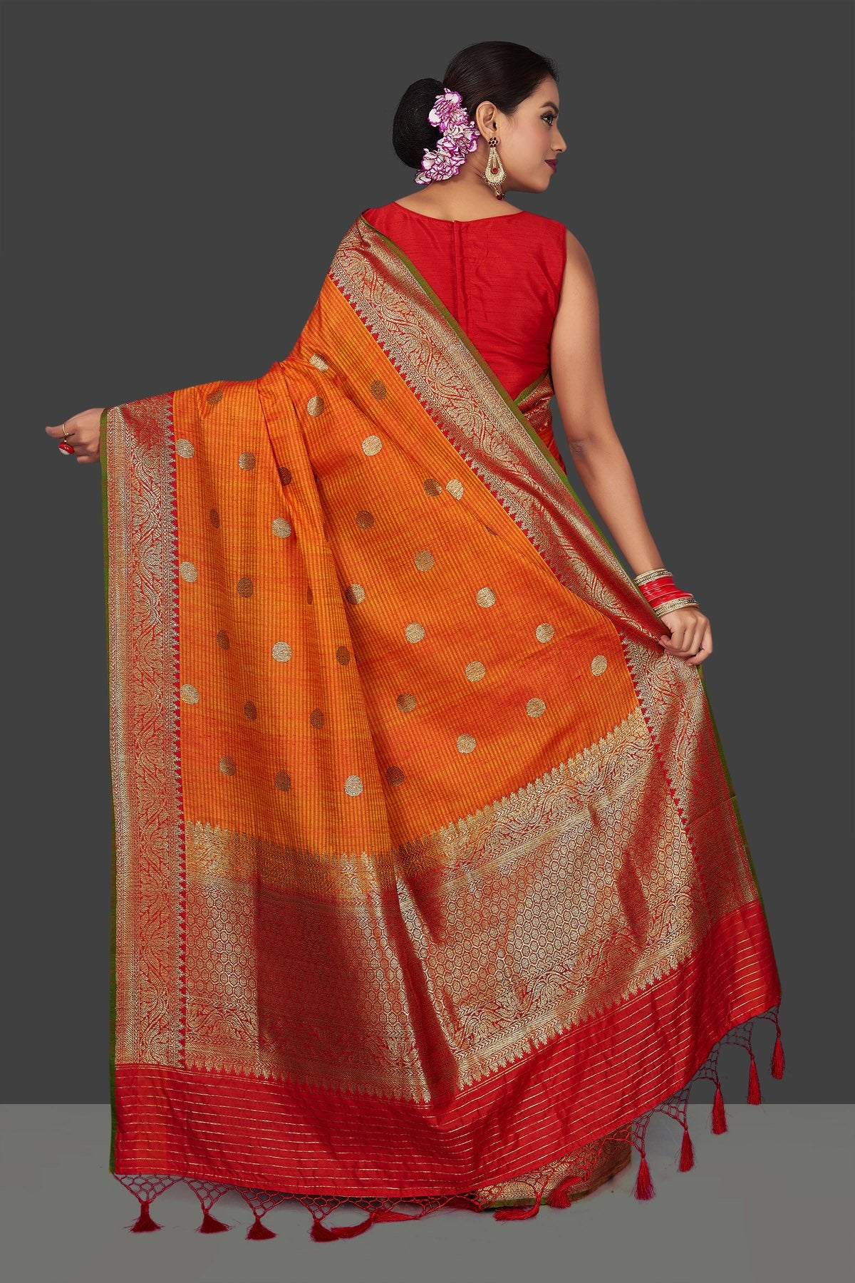 Shop beautiful orange tassar Banarasi saree online in USA with antique zari red border and zari buta. Garner compliments on weddings and special occasions with exquisite Banarasi saris, handwoven silk sarees, tussar sarees from Pure Elegance Indian fashion store in USA.-back
