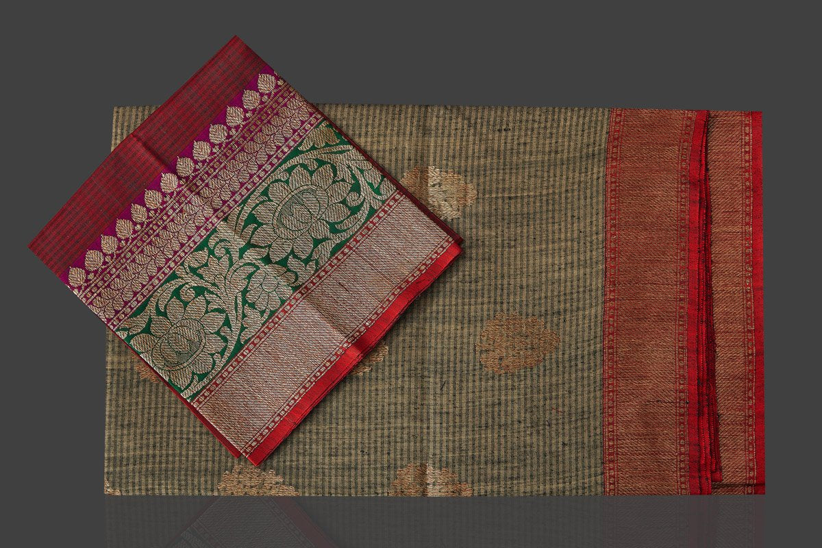Shop stunning grey striped tassar Banarasi saree online in USA with antique zari border and zari buta. Garner compliments on weddings and special occasions with exquisite Banarasi saris, handwoven silk sarees, tussar sarees from Pure Elegance Indian fashion store in USA.-blouse