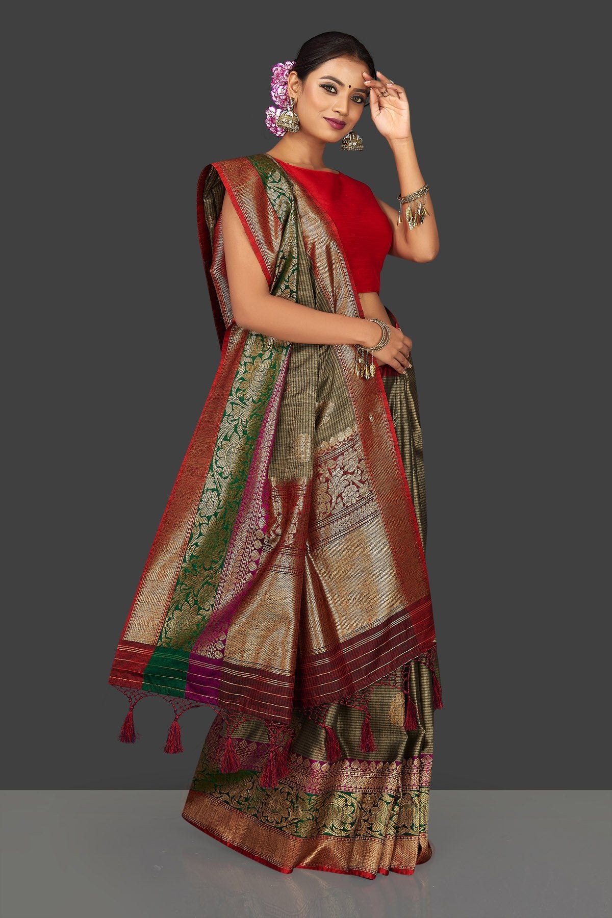 Shop stunning grey striped tassar Banarasi saree online in USA with antique zari border and zari buta. Garner compliments on weddings and special occasions with exquisite Banarasi saris, handwoven silk sarees, tussar sarees from Pure Elegance Indian fashion store in USA.-full view