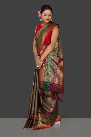Shop stunning grey striped tassar Banarasi saree online in USA with antique zari border and zari buta. Garner compliments on weddings and special occasions with exquisite Banarasi saris, handwoven silk sarees, tussar sarees from Pure Elegance Indian fashion store in USA.-side
