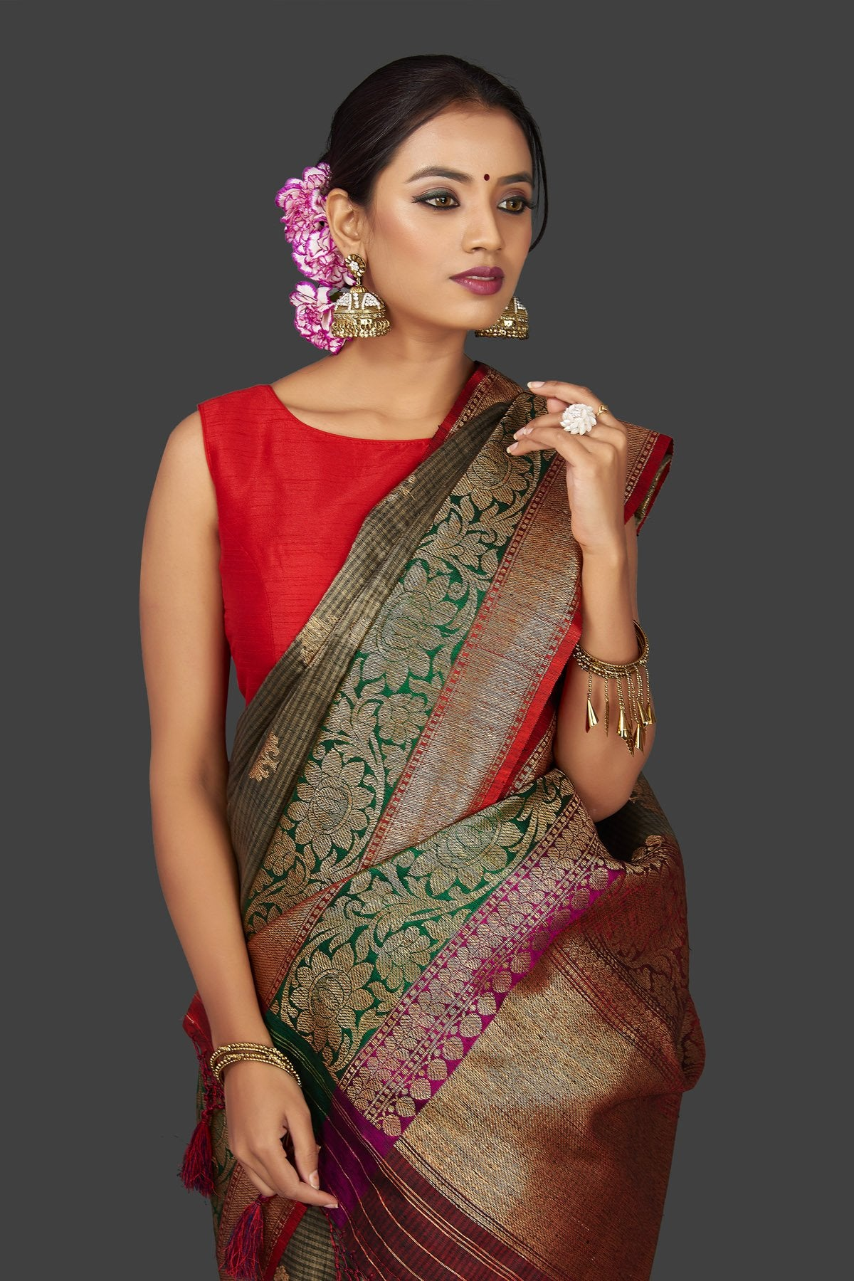 Shop stunning grey striped tassar Banarasi saree online in USA with antique zari border and zari buta. Garner compliments on weddings and special occasions with exquisite Banarasi saris, handwoven silk sarees, tussar sarees from Pure Elegance Indian fashion store in USA.-closeup