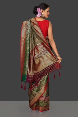 Shop stunning grey striped tassar Banarasi saree online in USA with antique zari border and zari buta. Garner compliments on weddings and special occasions with exquisite Banarasi saris, handwoven silk sarees, tussar sarees from Pure Elegance Indian fashion store in USA.-back