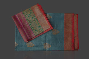 Buy gorgeous steel blue tassar Banarasi saree online in USA with antique zari border and zari buta. Garner compliments on weddings and special occasions with exquisite Banarasi sarees, handwoven silk sarees, tussar sarees from Pure Elegance Indian fashion store in USA.-blouse