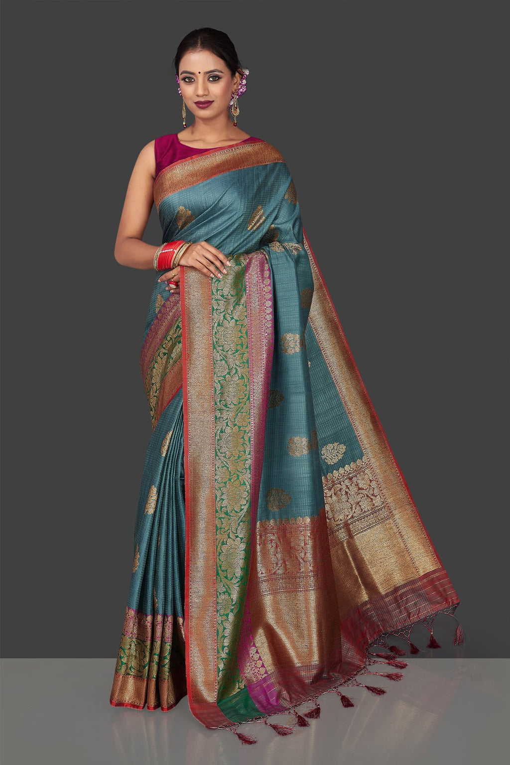 Buy gorgeous steel blue tassar Banarasi saree online in USA with antique zari border and zari buta. Garner compliments on weddings and special occasions with exquisite Banarasi sarees, handwoven silk sarees, tussar sarees from Pure Elegance Indian fashion store in USA.-full view