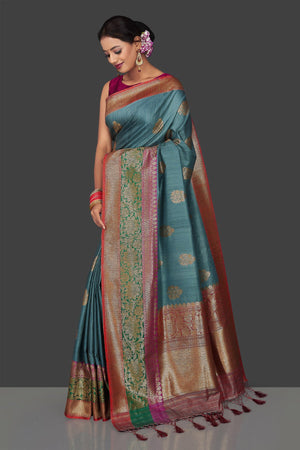 Buy gorgeous steel blue tassar Banarasi saree online in USA with antique zari border and zari buta. Garner compliments on weddings and special occasions with exquisite Banarasi sarees, handwoven silk sarees, tussar sarees from Pure Elegance Indian fashion store in USA.-side