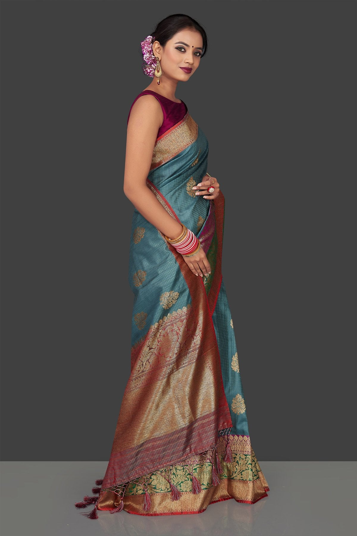 Buy gorgeous steel blue tassar Banarasi saree online in USA with antique zari border and zari buta. Garner compliments on weddings and special occasions with exquisite Banarasi sarees, handwoven silk sarees, tussar sarees from Pure Elegance Indian fashion store in USA.-right