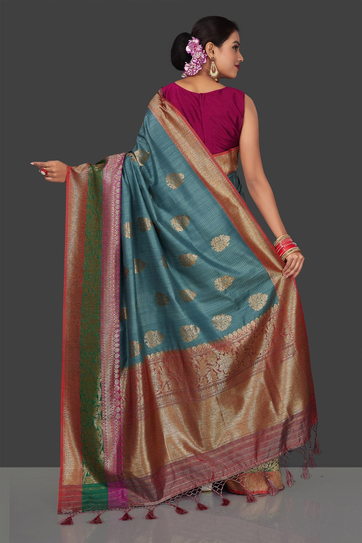 Buy gorgeous steel blue tassar Banarasi saree online in USA with antique zari border and zari buta. Garner compliments on weddings and special occasions with exquisite Banarasi sarees, handwoven silk sarees, tussar sarees from Pure Elegance Indian fashion store in USA.-back